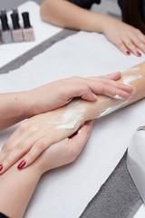 beautician doing Hand massage in beauty salon