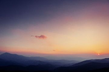 colorful sky with sun background in mountains. sunset, sunrise