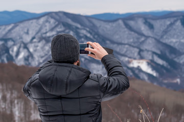 Hiker makes photo of mountains