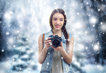 Professional photographer on winter landscape background