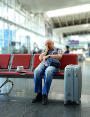 Man sleeping on bench in airport
