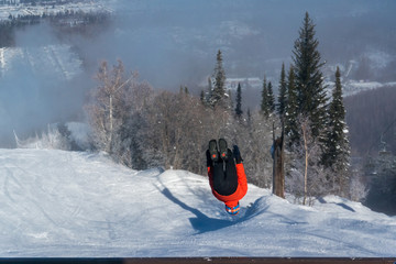 The guy doing a somersault in winter resort