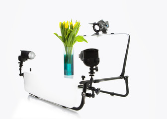 Still Life Photo shooting table with lights and Tulips, isolated on a white background for eBay, Amazon or product photograpy