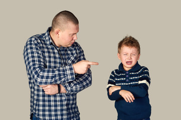father punishes son . Education . On a gray background