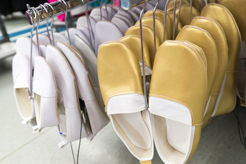 Gold and White Gym shoes in store