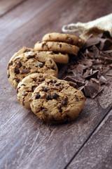 Fotobehang Koekjes Chocolate cookies on wooden table. Chocolate chip cookies shot
