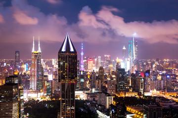 modern office buildings in shanghai at night