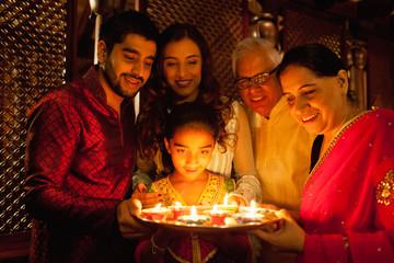 Family celebrating diwali.