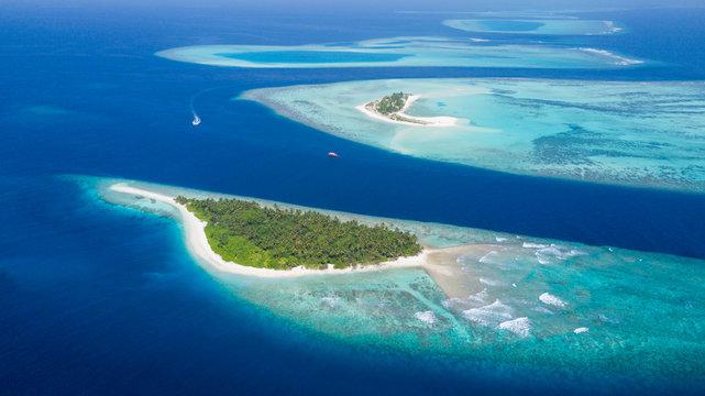 Small tropical island in Maldives atoll