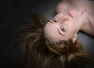 Beautiful hair. Top view of women with beautiful hair on dark background.