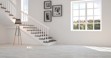 White room with stair and green landscape in window. Scandinavian interior design