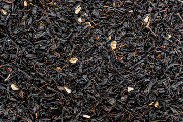Black tea background. Heap of dry black tea