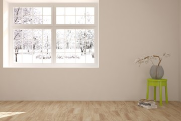 White room with chair and winter landscape in window. Scandinavian interior design