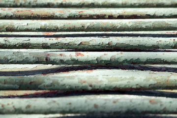 Old green metal bars close-up background