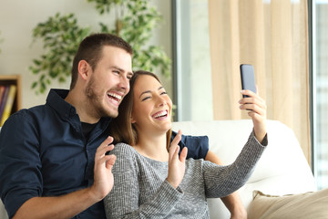Couple greeting in a phone video call