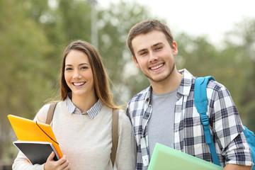 Two students looking at camera