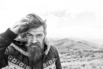 bearded handsome serious man on mountain top