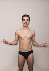 playful young man model posing arms gesture open