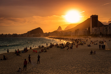Wall Mural - Sunset View in Copacabana Beach with Mountains in Horizon and Tall Hotel Building, Rio de Janeiro
