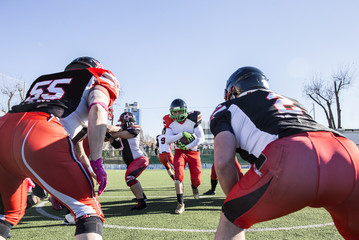 American football player running with the ball during a match