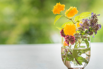 spring flowers in a glass vase on a table