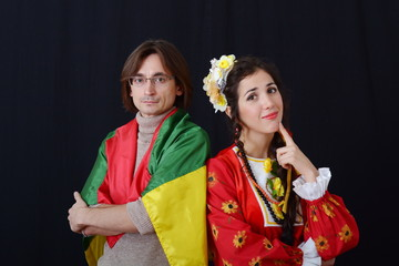 guy with glasses and a girl in ancient clothes talking on a dark background