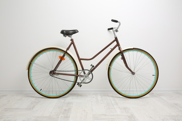 Bicycle on the background of white walls