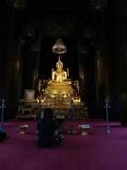 People meditate in a temple