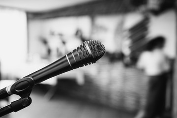Black and white art photography monochrome, microphone on a dark background. Evening in the restaurant. Conduct performance