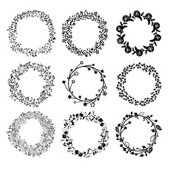 Set of wreaths. Botanical elements for design. Black beautiful wreaths on a white background. A collection of vintage ornaments for design.
