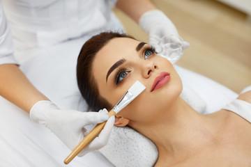 Cosmetician In Spa Salon Hydrating Beautiful Woman's Face