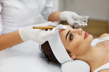 Cosmetician In Spa Salon Hydrating Beautiful Woman's Face