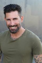 Striking man smiling close up