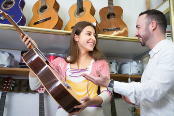 couple choosing acoustic guitar