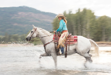 Mature woman riding horse, Missoula, Montana, USA
