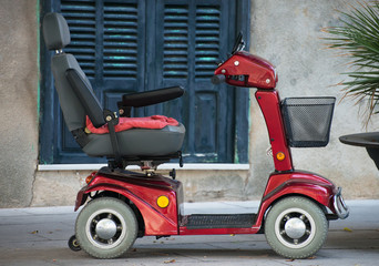 Motorized wheelchair car for disabled people. Wall mural