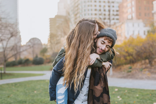 Young couple hugging in park, Boston, Massachusetts, USA