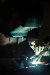 Metalworker working in foundry, close-up