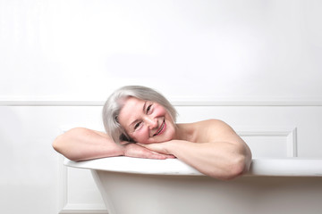 Lady smiling in bath tub