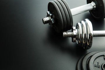 The metal dumbbell and weights.