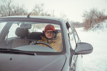 Man driving car using smart phone in car