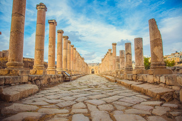 Ancient Roman ruins, walkway along the columns in Jerash, Jordan