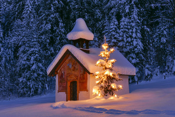 Illuminated Christmas tree in front of a chapel in winter, Bavaria, Upper Bavaria, Germany, Europe Wall mural