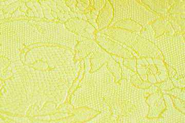 Genuine leather with an abstract ornament, tender light green color. Closeup on a leather texture. For modern pattern, wallpaper or banner design.