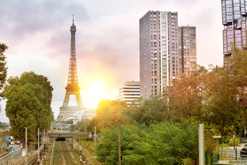 Railway and Eiffel Tower in Paris, France. Sunset over sityscape.