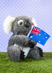 A very cute stuffed toy koala with an Australian flag.