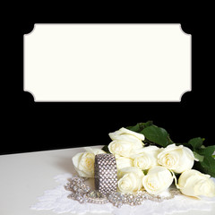 Elegant black background with text area above and below are white dreamy cream roses with faux diamond bracelet and necklace on lace.