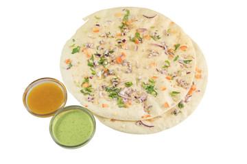 Indian appetizer cracker masala papadum with garnish with mango and mint chutney