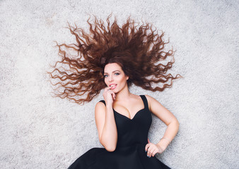 Woman with beauty long brown hair lying on the floor