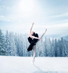 Graceful female ballet dancer stretching